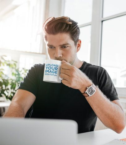 11 oz Coffee Mug Mockup Featuring a Man Working from Home 43550-r-el2