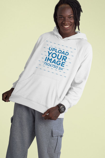 Mockup of a Joyful Man Wearing a Pullover Hoodie and Posing Against a Plain Color Backdrop 42978