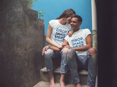 Mockup of a Young Couple Having Fun While Using Matching Round Neck Tees Sitting in Stairways a13457