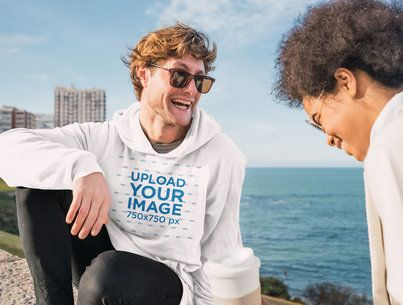 Pullover Hoodie Mockup of a Man at the Beach Talking with a Friend 40479-r-el2