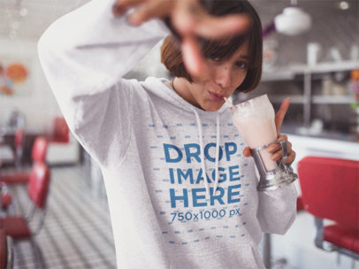 Template of a Short Haired Girl Drinking a Milkshake While Wearing a Pullover Hoodie in a Restaurant a12675
