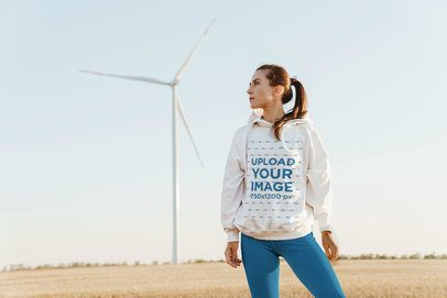 Hoodie Mockup Featuring a Woman and a Wind Turbine in the Background 42805-r-el2
