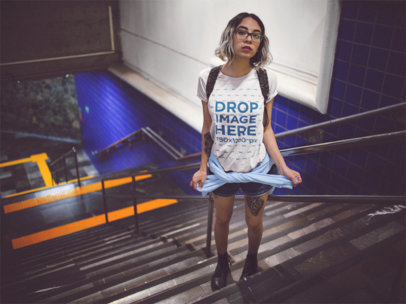 Edgy Short Haired Girl With Glasses Wearing a Round Neck Tee While in the Subway Stairways Template a13554
