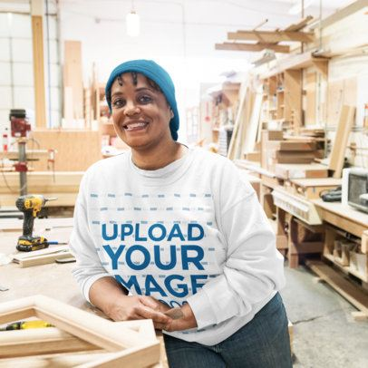 Crewneck Sweatshirt Mockup Featuring a Woman at a Wood Workshop 42449-r-el2