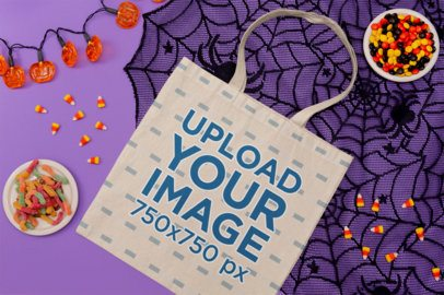 Mockup of a Flat Laid Tote Bag Featuring Halloween Candy m111