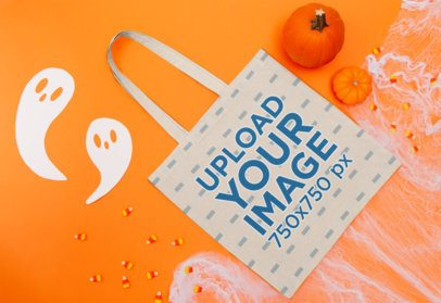 Mockup of a Flat Laid Tote Bag Featuring a Halloween Setting m113