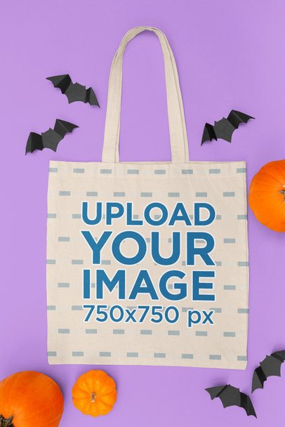 Mockup of a Flat Laid Tote Bag on a Halloween-Decorated Setting 112