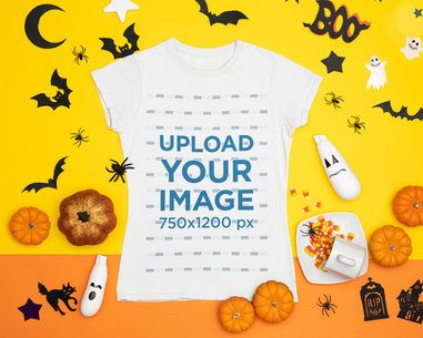 Halloween-Themed Mockup Featuring a T-Shirt Placed Among Spooky Decorations 96