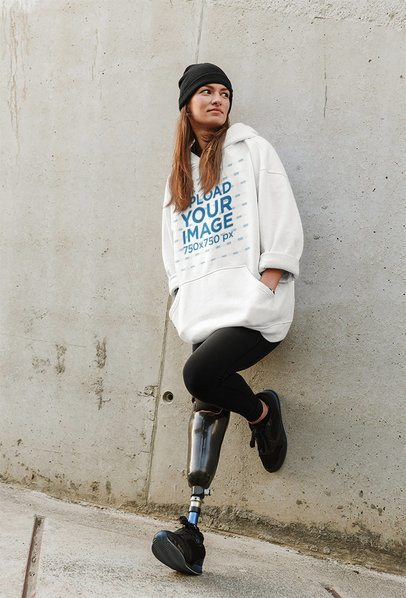 Mockup of a Woman in an Oversized Hoodie with a Street Style Leaning on a Wall 40273-r-el2