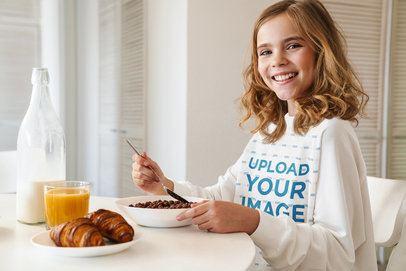 Sweatshirt Mockup of a Smiling Girl Eating Breakfast 40245-r-el2
