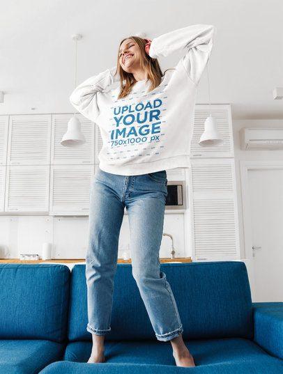 Sweatshirt Mockup of a Happy Woman Dancing on the Couch 40365-r-el2