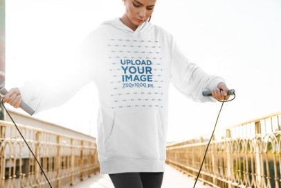 Mockup of a Woman Wearing an Oversized Hoodie While Exercising 40733-r-el2