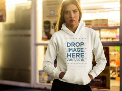 Young White Girl Wearing a Pullover Hoodie While Outside of the Supermarket Mockup a13552