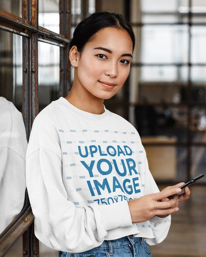 Mockup of a Woman with a Cropped Sweatshirt Holding a Phone 39836-r-el2