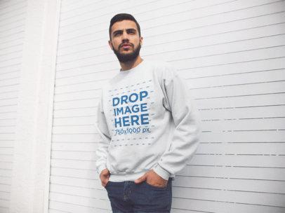Young Hispanic Man Wearing a Crewneck Sweatshirt While Standing Near a White Facade Template a13427