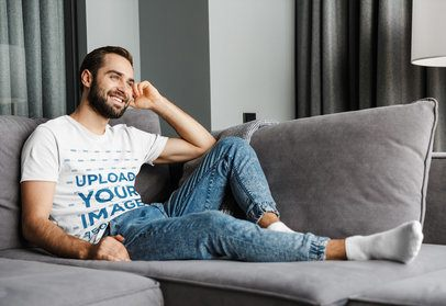 T-Shirt Mockup of a Man Relaxing in His Living Room 40311-r-el2