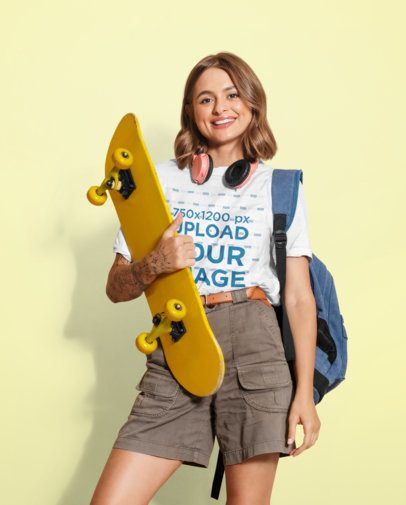 T-Shirt Mockup of a Woman Holding a Skateboard in a Studio 40363-r-el2