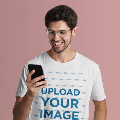 Studio Mockup of a Man in a T-Shirt Checking His Phone 42820-r-el2