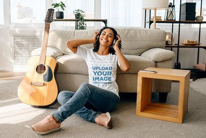 T-Shirt Mockup of a Woman Sitting Next to a Guitar 39156-r-el2