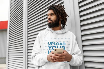 Hoodie Mockup Featuring a Man with Locs Using His Phone 41731-r-el2