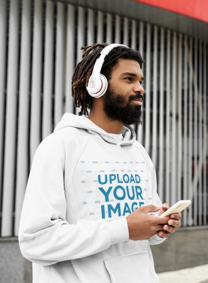 Mockup of a Man with a Hoodie and Headphones Walking on the Street 42624-r-el2