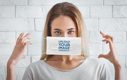 Mockup of a Serious Woman Showcasing a Face Mask 43938-r-el2