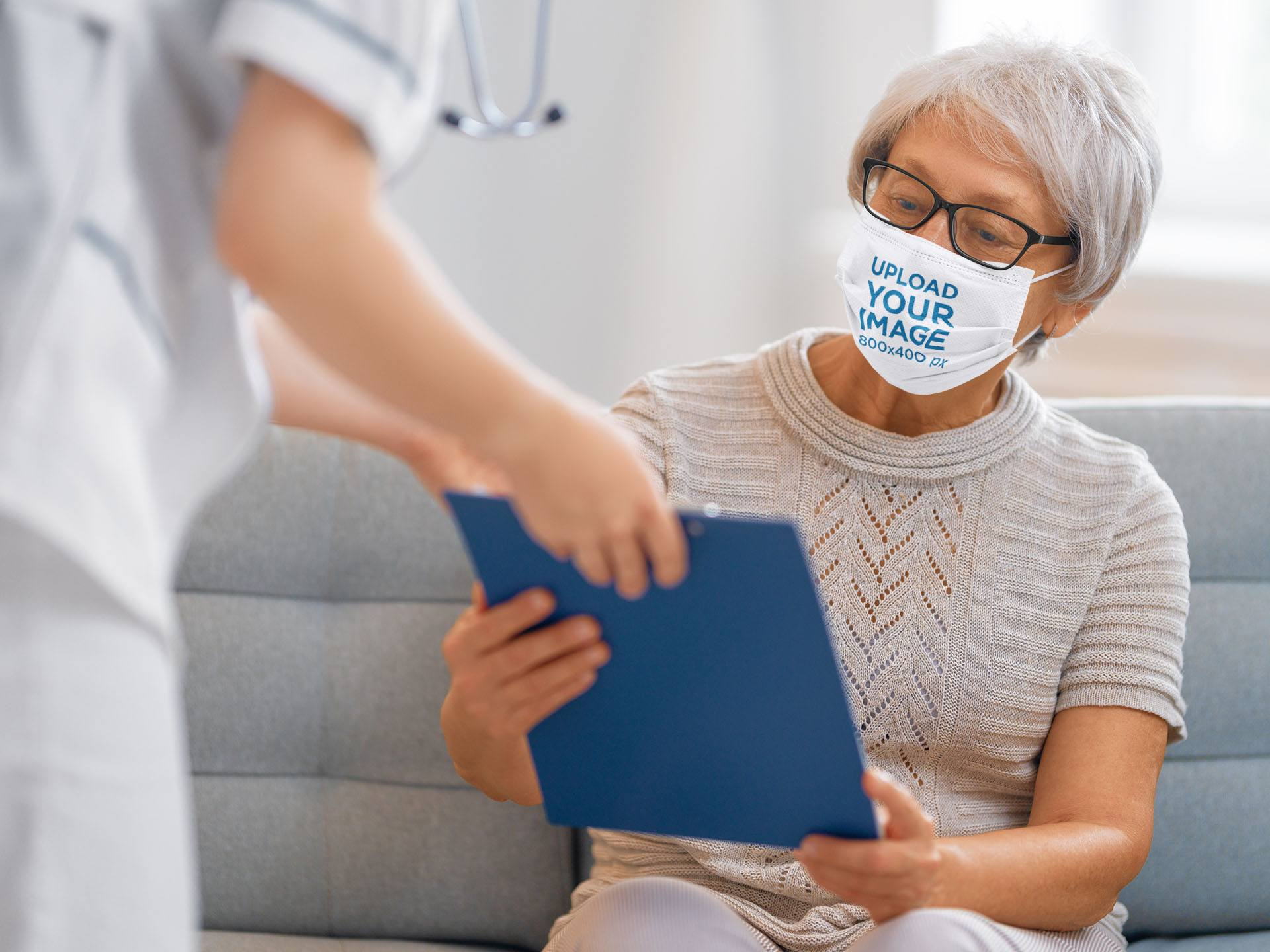 Face Mask Mockup Featuring a Senior Woman at the Doctor's 43785-r-el2