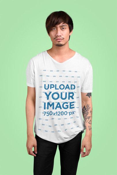 V-Neck T-Shirt Mockup Featuring a Tattooed Man in a Studio 40089-r-el2