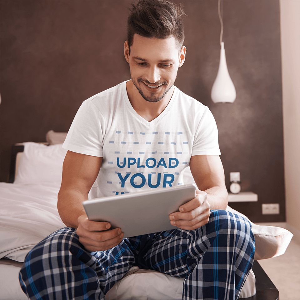 V-Neck T-Shirt Mockup of a Man Using a Tablet in the Morning 35694-r-el2