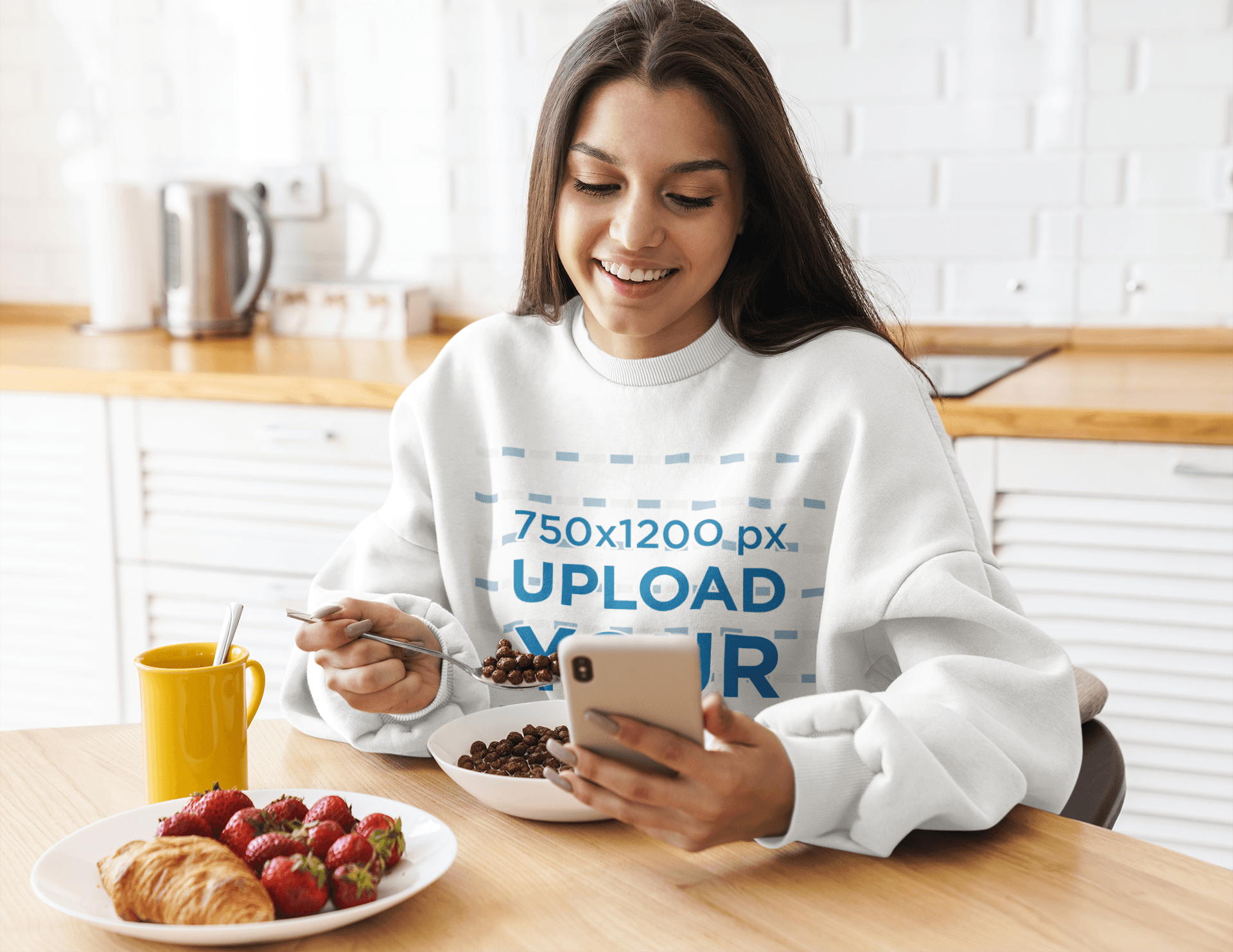 Sweatshirt Mockup of a Young Woman Checking Her Phone While Having Breakfast 41302-r-el2