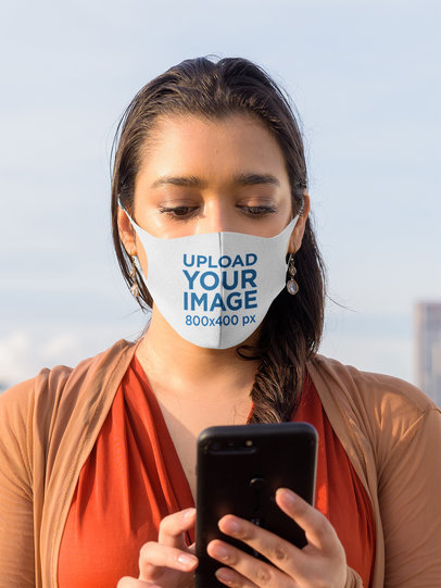 Face Mask Mockup Featuring a Serious Woman Texting 44035-r-el2