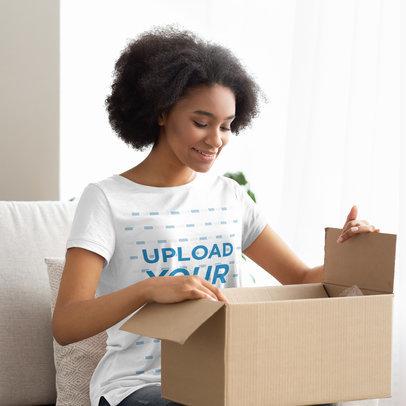 T-Shirt Mockup Featuring a Woman Opening a Box 39949-r-el2