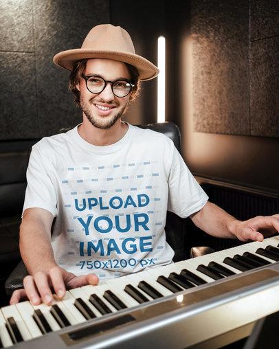 T-Shirt Mockup Featuring a Keyboardist in a Studio 39728-r-el2