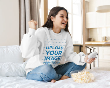 Mockup Featuring a Female Gamer Wearing a Sweatshirt at Home 41308-r-el2