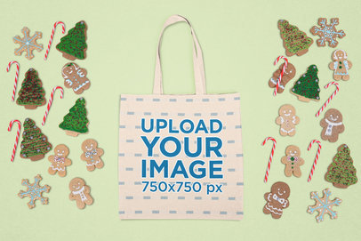 Mockup of a Flat Laid Tote Bag Surrounded by Winter Decorations m26