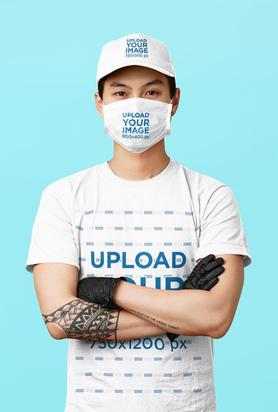 T-Shirt and Face Mask Mockup of a Man Wearing a Dad Hat in a Studio 43969-r-el2