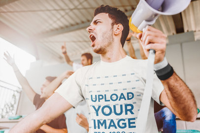 T-Shirt Mockup of a Man Watching a Soccer Match Holding a Megaphone 43810-r-el2