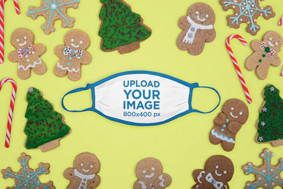 Mockup of a Flat Laid Face Mask Surrounded by Christmas Gingerbread Cookies m28