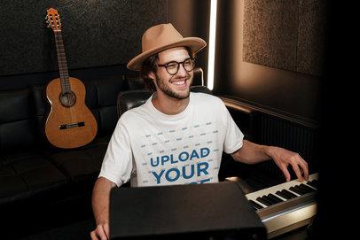 T-Shirt Mockup Featuring a Happy Man Playing Music at a Recording Studio 40165-r-el2