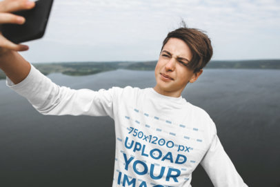 Mockup of a Teenager with a Long-Sleeve Tee Taking a Selfie at a Lake 43686-r-el2