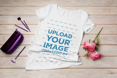 Mockup of a Scoop-Neck Tee Featuring a Rose and a Makeup Kit 41378-r-el2