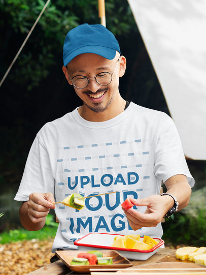 T-Shirt Mockup of a Man Eating Fruit at a Campsite 43071-r-el2