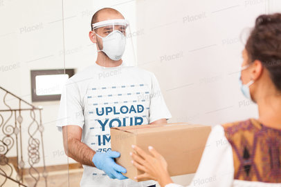 T-Shirt Mockup Featuring a Delivery Man Handling a Box 43016-r-el2