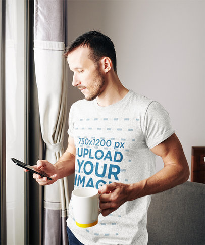 Mockup of a Man Wearing a Heathered Tee While Having a Coffee at Home 42308-r-el2