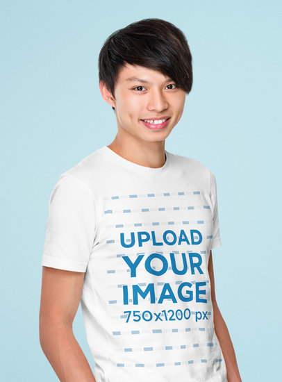 Mockup of a Happy Young Man Wearing a T-Shirt and Posing Against a Colored Backdrop 44582-r-el2