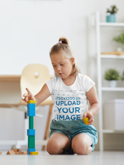 T-Shirt Mockup Featuring a Girl Playing with Blocks at Home 43004-r-el2