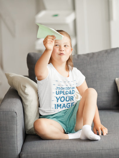 T-Shirt Mockup of a Girl Playing with a Paper Plane 42998-r-el2