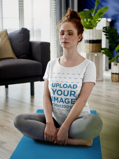 T-Shirt Mockup of a Woman with Freckles Meditating at Home 43028-r-el2