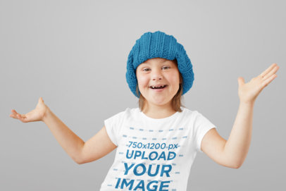 Mockup of a Happy Little Girl Wearing a T-Shirt at a Studio 43002-r-el2