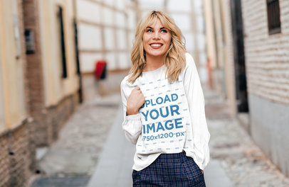 Mockup of a Happy Woman with a Long-Sleeve Tee Walking in the City 44318-r-el2